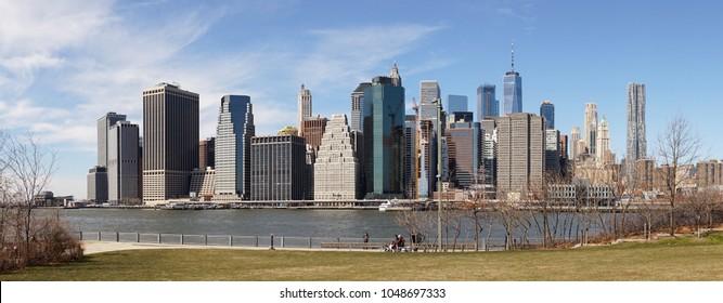 Views on Manhattan Skyline from Brooklyn Bridge Park in New York City.