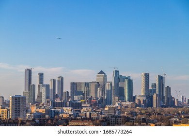 Views over the city of London towards Canary Wharf. Showing the skyline during the day with lots of copy space in the sky