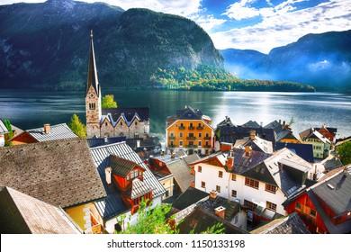 Views over roofs of the lake and Hallstatter and Hallstatt Lutheran Church. Location: resort village Hallstatt, Salzkammergut region, Austria, Alps. Europe.
