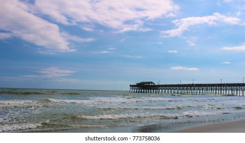 Views of the pier in Garden City, South Carolina. Blue skies and blue ocean
