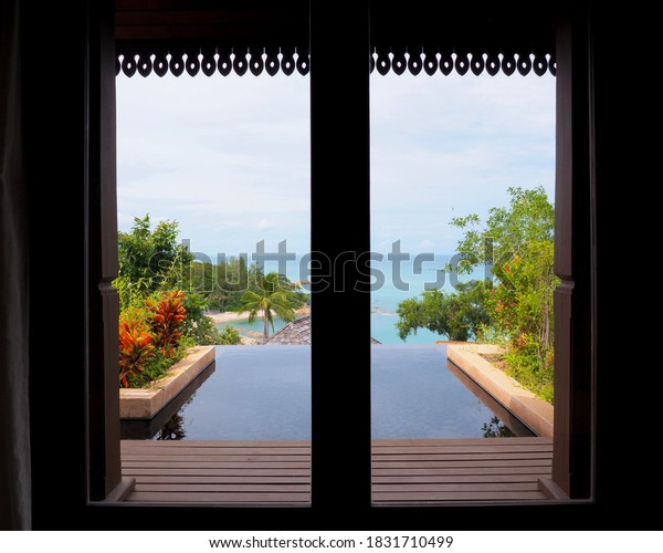 Views of the pool and sea from the window. at The Ritz-Carlton Koh Samui