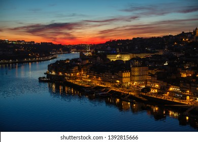 Views of the Ribeira and Douro river from Dom Luis I bridge during a beautiful twilight, Porto, Portugal.