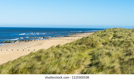 Views from the sand dunes on the North Norfolk coast.The long sandy beach backed by dunes on the Norfolk coast.
