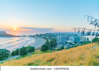 Views from slopes of Mount Maunganui above Main Beach and coastal landscape