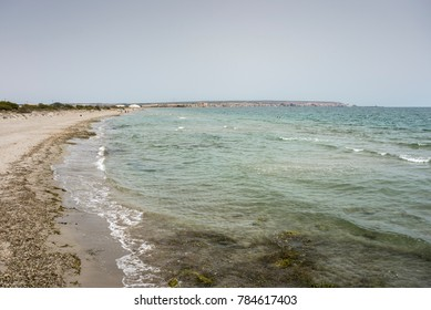 Views of Tamarit Beach, in Santa Pola, Alicante, Spain, by the Mediterranean Sea. In the background can be seen de city and mountains of salt