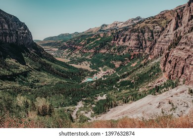 Views of Telluride Valley with surrounding San Juan Mountains from the Bridal Veil Falls Trail. Telluride, Colorado, USA, is a historic mining town and popular ski resort.