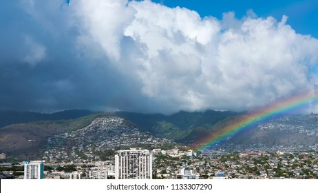 Views from Waikiki Beach resort towards the tropical rainforest known as Honolulu Watershed Forest Reserve and the developments of Manoa and Palolo, Oahu Island, Hawaii, USA