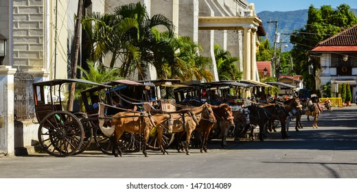 Vigan, Ilocos Sur/PH - Dec. 16, 2012: Horse-drawn carriages (calesas) with their operators waiting for passengers, Vigan, Ilocos, Sur, Philippines