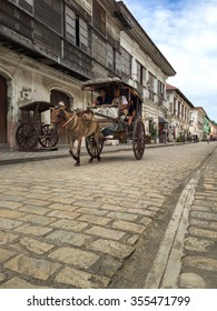 VIGAN, PHILIPPINES - JULY 25, 2015 : A Kalesa (or Horse Carriage) in Historic Town of Vigan. Vigan is a UNESCO World Heritage Site in that it is one of the few Spanish colonial town