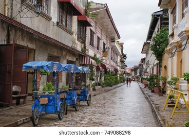 Vigan, Philippines - June 17, 2009: People and tricycles are seen in the beautiful colonial cobblestone streets of Vigan in North Luzon, Philippines. Unesco World Heritage Site