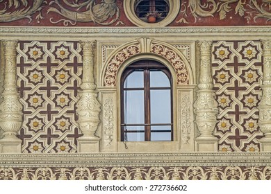 Vigevano - Detail view of a Renaissance palace with sand-colored facades and eggplant-colored paintings