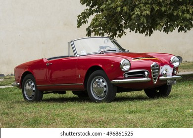 VIGEVANO / ITALY - OCTOBER 01, 2016: A red Alfa Romeo Giulietta Spider. Shot in Sforza castle, during the XX Trofeomilano, a meeting of vintage cars.