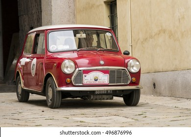 VIGEVANO / ITALY - OCTOBER 01, 2016: A red old Mini Cooper. Shot in Sforza castle, during the XX Trofeomilano, a meeting of vintage cars.