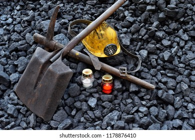Vigil light, candle with the miner belongings (helmet, pickaxe, shovel, belt) after the fatal accident in the mine