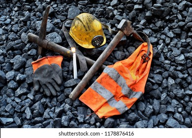Vigil light, candle with the miner belongings (helmet, gloves, pickaxe, vest, belt) after the fatal accident in the mine