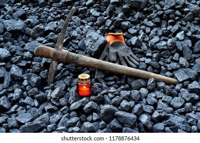 Vigil light, candle with the miner belongings (gloves, pickaxe) after the fatal accident in the mine
