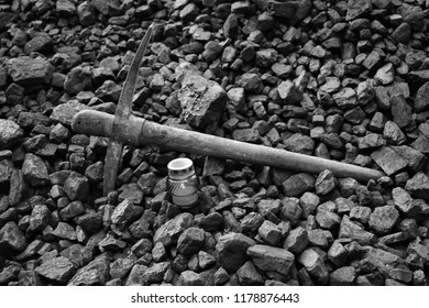Vigil light, candle with the miner pickaxe after the fatal accident in the mine, black and white photo