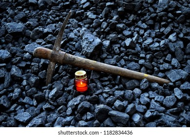 Vigil light, candle with the miner pickaxe after the fatal accident in the mine