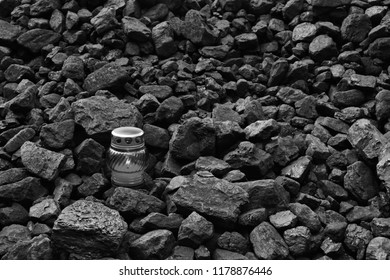 Vigil light, candle on cheap of coal after the fatal accident in the mine, black and white photo