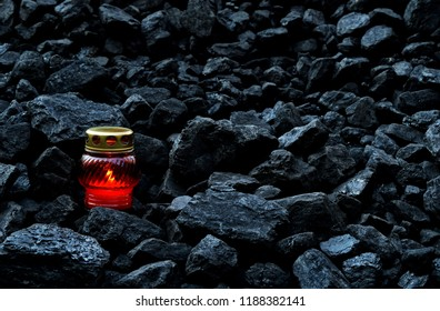Vigil light, candle on cheap of coal after the fatal accident in the mine