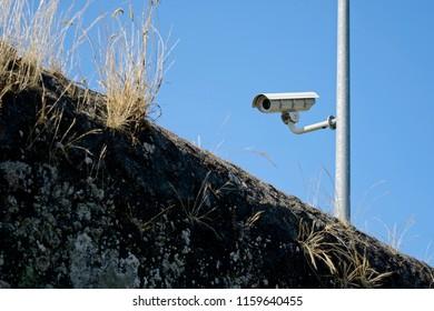 Vigilance camera with blue sky on background. Sunny day