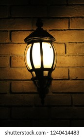 Vigilant lamp in brick wall