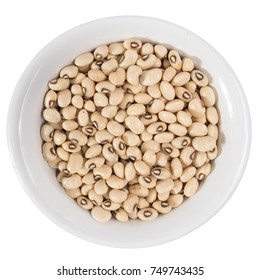 Vigna unguiculata is scientific name of Black Eyed Pea legume. Also known as Goat Pea, California Blackeye and Feijao Fradinho. Top view of grains on ceramics bowl.