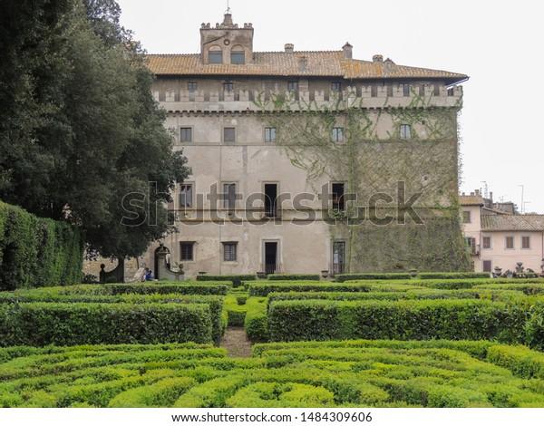 VIGNANELLO, LAZIO, ITALY - April 22 2019: Facade of Castello Ruspoli, a16th-century castle that is located in Vignanello, Viterbo (Italy). The castle is famous for the Renaissance italian garden.