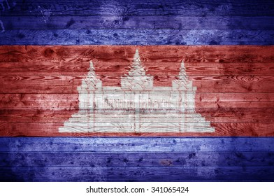 A vignetted background image of the flag of Cambodia painted onto wooden boards of a wall or floor.