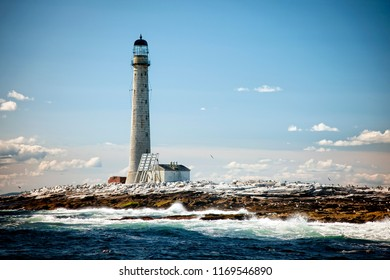 Vignetted Image of Boon Island lighthouse at low tide in Maine on a summer day. It is the tallest lighthouse in New England.
