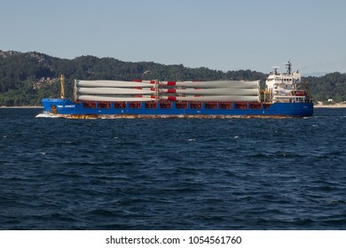 Vigo, Galicia, Spain, Sep 3, 2.015.  Large ship transporting windmill propellers to produce electricity