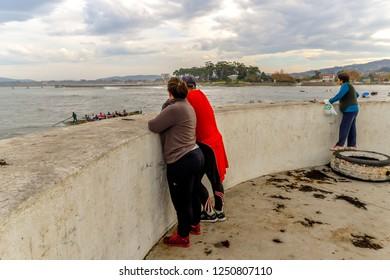 Vigo/Galicia - Spain - 11/25/18 - People watching a boat race in a Canido