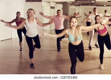 vigorous people dancing aerobics at lesson in the dance class