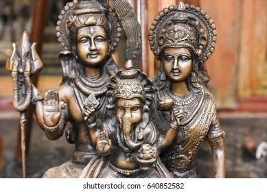 Vijayanagar period bronze sculpture of the Hindu gods Shiva, Parvati, son Ganesha, India. Statue of Indian goddess and her son with elephant head. - Shutterstock ID 640852582
