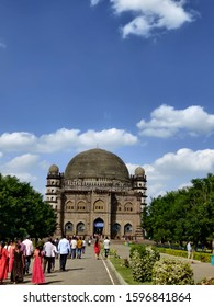 vijayapura karnataka India, 14 13 2019: Golgumbaz with blue sky and tourists walking towards it