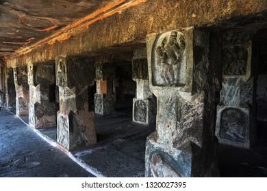 VIJAYAWADA, ANDHRA PRADESH, INDIA, JANUARY 07, 2019: Undavalli Cave temple. Corridor carved into the huge rock, supported by huge stone pillars..