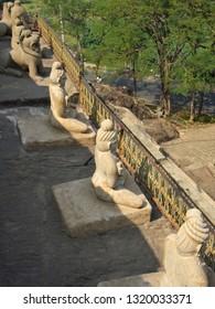 VIJAYAWADA, ANDHRA PRADESH, INDIA, JANUARY 07, 2019: Undavalli Cave temple. Sandstone statues of meditating sages outside the temple, angular view.
