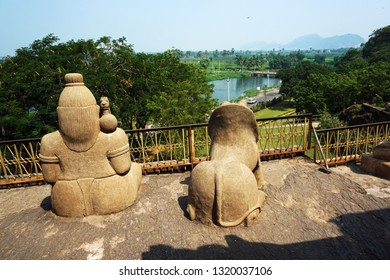 VIJAYAWADA, ANDHRA PRADESH, INDIA, JANUARY 07, 2019: Undavalli Cave temple. View of the village from the top of the temple. Statues of Meditating sage and lions on a sunny day.