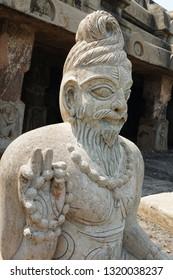 VIJAYAWADA, ANDHRA PRADESH, INDIA, JANUARY 07, 2019: Undavalli Cave temple. Statue of a meditating sage, outside the temple.