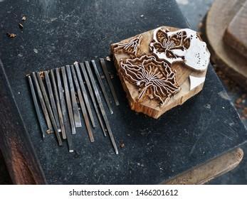 Vijayawada, Andhra Pradesh, India, March 23, 2019: Making of Kalamkari design blocks. Intricate designs are engraved on wooden blocks with fine chisels by traditional craftsmen.