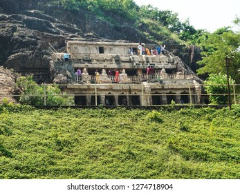 VIJAYAWADA, ANDHRA PRADESH, INDIA, OCTOBER 21, 2018: Visitors at the Undavalli Caves, 6 km from Vijayawada. The caves are carved out of solid sandstone on a hillside. Monolithic rock-cut architecture.
