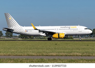 VIJFHUIZEN, THE NETHERLANDS - June 20, 2018: Spanish Vueling Airbus A320-200 with registration EC-MXG just landed on runway 18R (Polderbaan) of Amsterdam Airport Schiphol.
