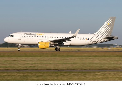 VIJFHUIZEN, THE NETHERLANDS - June 28, 2019: Spanish Vueling Airbus A320-200 with registration EC-LVU on take off roll on runway 36L (Polderbaan) of Amsterdam Airport Schiphol.