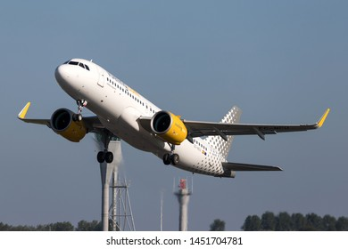 VIJFHUIZEN, THE NETHERLANDS - June 28, 2019: Spanish Vueling Airbus A320neo with registration EC-NCU just airborne at Amsterdam Airport Schiphol.