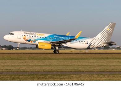 VIJFHUIZEN, NETHERLANDS - June 28, 2019: Spanish Vueling Airbus A320-200 with registration EC-MLE in special Disneyland Paris livery taking off runway 36L (Polderbaan) of Amsterdam Airport Schiphol.