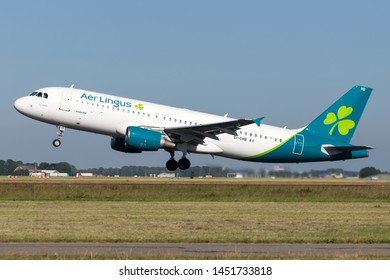 VIJFHUIZEN, THE NETHERLANDS - June 28, 2019: Irish Aer Lingus Airbus A320-200 with registration EI-CVB taking off runway 36L (Polderbaan) of Amsterdam Airport Schiphol.