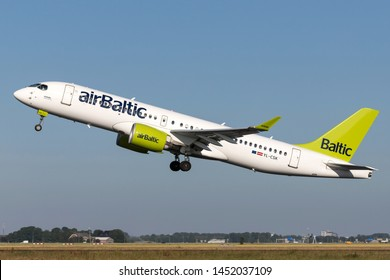 VIJFHUIZEN, THE NETHERLANDS - June 28, 2019: Latvian airBaltic Airbus A220-300 with registration YL-CSK taking off runway 36L (Polderbaan) of Amsterdam Airport Schiphol.