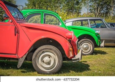 VIJFHUIZEN, NETHERLANDS - MAY 06, 2017: Two Citroen 2CV antique oldtimers and a Citroen DS in one frame