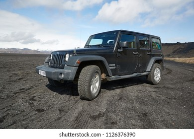 VIK, ICELAND - MAY 03, 2018: Jeep Wrangler Unlimited Sport four wheel drive vehicle being used on terrain on a black sand beach in Iceland