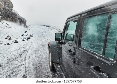 VIK, ICELAND - MAY 03, 2018: Jeep Wrangler Unlimited off road car driving in Iceland, snow on a wild landscape